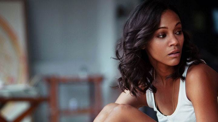 Zoe Saldana Sitting Pose In White Top